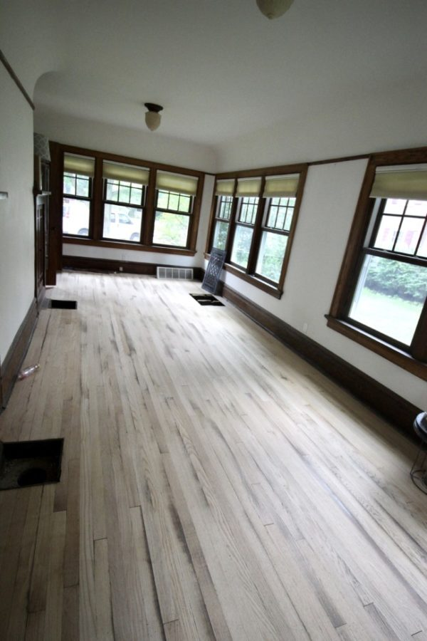 sanded floors in my sunroom waiting to be stained.