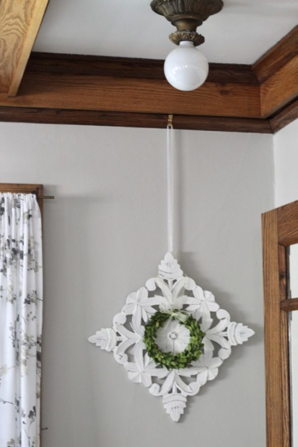 home decor hanging from picture rail