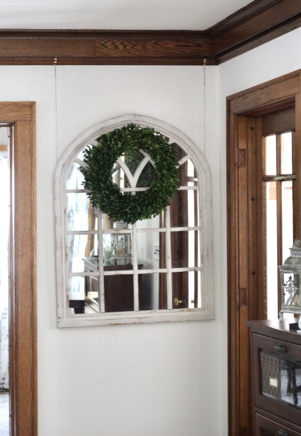 picture rail molding used to hang a decorative mirror