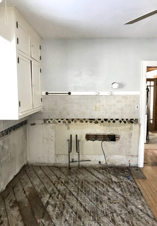 kitchen with cabinets torn out and flooring ripped out