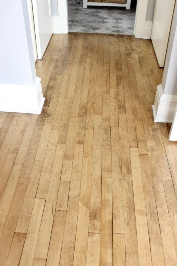 closeup of beautifully refinished vintage maple flooring.