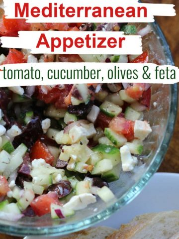 mediterranean appetizer with chopped tomato, cucumber, olives and feta