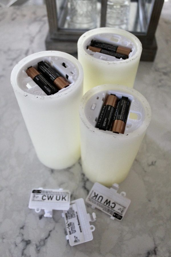 Batteries put into white candles