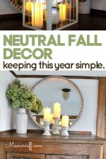 fall decor including candles, hydrangeas and cream colored vase, candleholders and round mirror frame