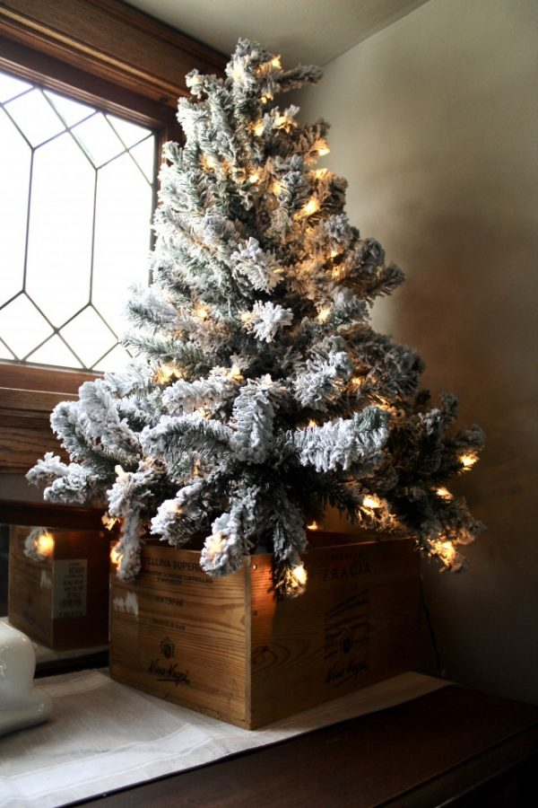 Flocked christmas tree in a wooden wine box
