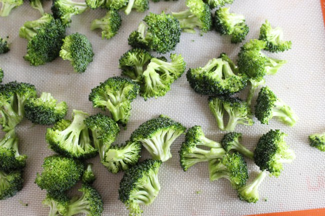 broccoli florets spread out on a sheet pan